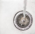 Water in kitchen sink iii flowing down the hole a Royalty Free Stock Photos