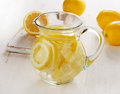 Water with lemon and ice in a glass jug. Royalty Free Stock Photo
