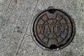 Water main manhole cover Royalty Free Stock Photo