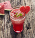 Water melon smoothie and fresh melon on wood background Royalty Free Stock Photo