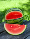 Water melon on wooden garden table outdoors Stock Photography