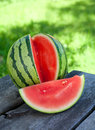 Water melon on wooden table outdoors Royalty Free Stock Photography