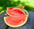 Water melon on wooden table outdoors Royalty Free Stock Image
