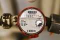 Image : Water meter fitted to the mains system apartment. Industry concept.  rusty use