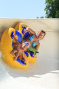 Water park rhodes greece faliraki august mom and daughter drive with tube on the rafting slide in the rafting slide is one of many Royalty Free Stock Photos