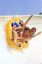 Water park rhodes greece faliraki august two cheerful girls smiling and with open arms drive with tube on the rafting slide in the Stock Images