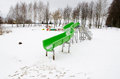 Water park slide snow lake winter playground outdoor on frozen snowy in Stock Photos