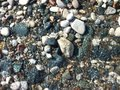 Water on pebbles rushing over the beach Stock Images