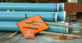 Water pipe colorful blue pipes are ready to install during the roadside construction Royalty Free Stock Photo
