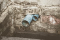 Water pipe in dirty sewer Royalty Free Stock Photo
