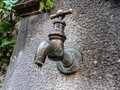 Water pipe on an old stone well Royalty Free Stock Photo
