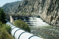 Water pipeline diverting from a river to supply a hydroelectric dam Royalty Free Stock Photos