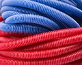 Water pipes closeup view of long red and blue Stock Photography