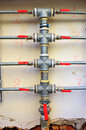 Water pipes home with red valves Royalty Free Stock Photos