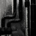 Water pipes on the painted wall background