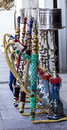 Water pipes in a row view from the colorful hookah front of tobacco shop Stock Photos