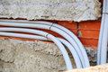 Water pipes in the wall plastic outside Stock Photos