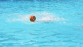 Water polo ball splashed in a pool Royalty Free Stock Image