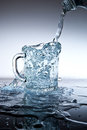 Water pouring into the cup of the bottle Royalty Free Stock Image