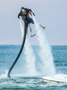 Water propelled jetpack man enjoying with jet pack lift on Royalty Free Stock Photography