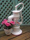 Water pump garden ornament flowers Royalty Free Stock Photo