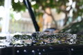 Water rain droplet on black car with glass coating Royalty Free Stock Photo