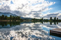 Water Reflection Clouds Trees Boat Dock Royalty Free Stock Photo
