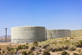 Water reserve tanks several sit up on a hill in a residential community Stock Photo