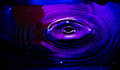 Water ripple purple and red Royalty Free Stock Images