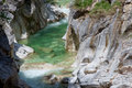 Water running down mountain gorge in the alps Royalty Free Stock Images