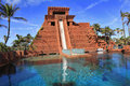 The water slide structure in paradise island the bahamas with sharks aquarium on foreground surrounded by palm trees Stock Images
