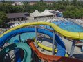 Water slides in aqua park at outdoor swimming pool Royalty Free Stock Photo