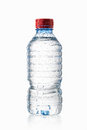 Water. Small plastic water bottle with water drops on white back Royalty Free Stock Photo