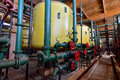 Water softening plant indoor architecture of yellow boilers with chemicals Stock Photo