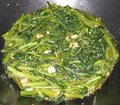 Water spinach sautéed with shrimps and garlic Stock Images