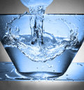 Water splash in a bowl Royalty Free Stock Photo