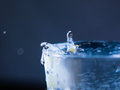 Water splash in dark blue color with a drop of water Royalty Free Stock Photo