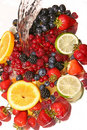 Water splash and fruits Stock Image