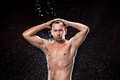 The water splash on male face Royalty Free Stock Photo