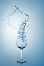 Water Splash in Wine Glass. Stock Photo