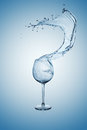 Water Splash in Wine Glass. Royalty Free Stock Images
