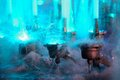 Water splashing on blue lights in a fountain detail of with falling back them Stock Images