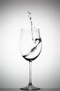 Water splashing in a wine glass Royalty Free Stock Photo