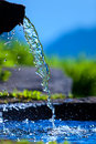 Water spring on alps mountains background Stock Image