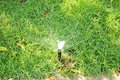 Water sprinkler spraying on green grass sprinklers over lawn Royalty Free Stock Photos