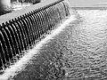 Water streams a balck and white look at of in a new york city fountain Stock Photo