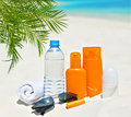 Water and sun protection cream on beach background body care health care Royalty Free Stock Photography