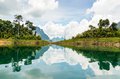 Water surface reflecting sky and cloud at ratchapapha dam in khao sok national park surat thani province guilin of thailand Royalty Free Stock Image