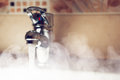 Water tap with hot water steam Royalty Free Stock Photo