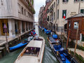 A water Taxi negotiating a busy canal in Calle Larga XX11 Marzo, Venice, Italy - May 2010 Royalty Free Stock Photo